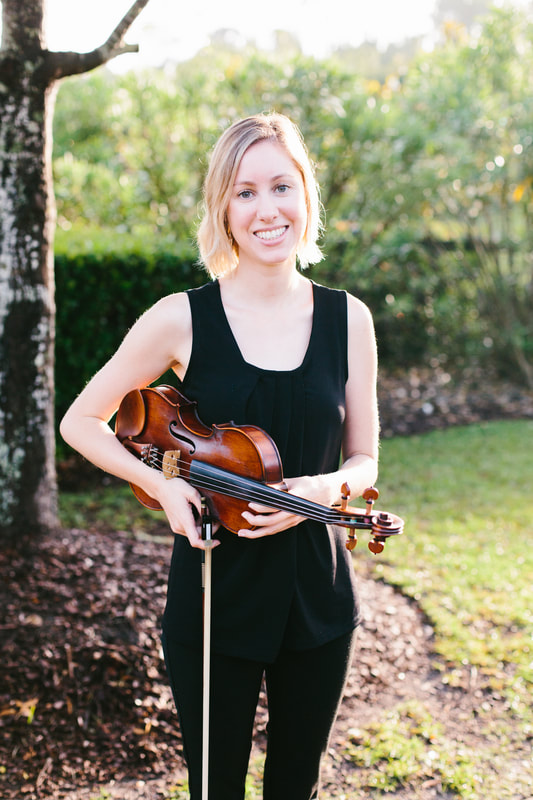 Erin Norton, SC Music Lessons LLC Instructor, Holding her Violin